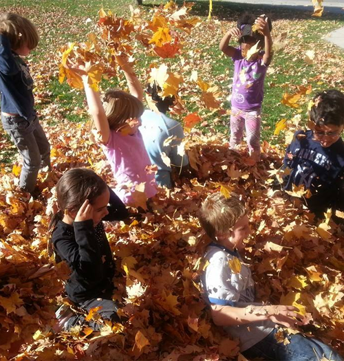 Kids Playing with Fall Leaves